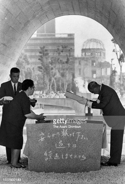 Hiroshima City Mayor Setsuo Yamada dedicates the victims name books beneath the cenotaph during the Peace Memorial Ceremony on the 25th anniversary...