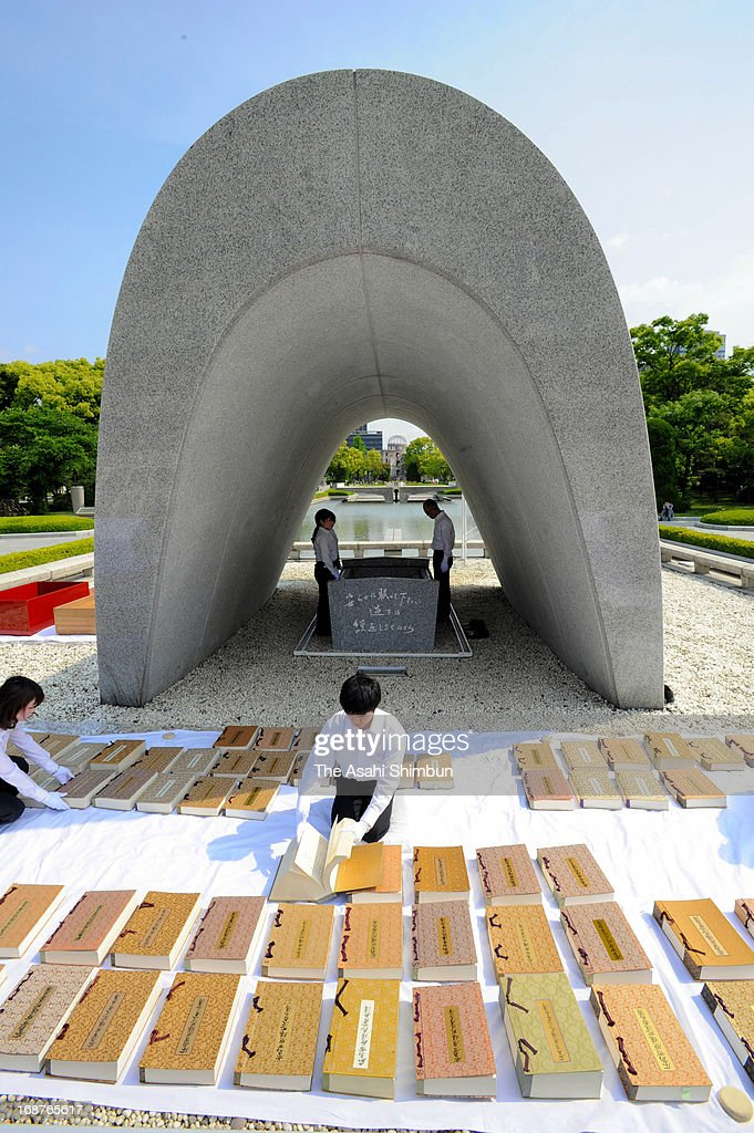 A Hiroshima City officer wearing white gloves airs the name books of atomic bombs victims of Hiroshima and Nagasaki to check whether there are any damages at Hiroshima Peace Memorial Park on May 15, 2013 in Hiroshima, Japan. The officers check each pages of 103 books, that recorded 280,968 victims' names and the date of death. A name book recording the victims who passed away after last year's peace memorial will be dedicated to the stone chamber located underneath the peace monument at this year's Peace Memorial on August 6.