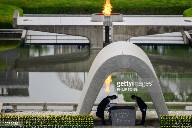 TOPSHOT Hiroshima mayor Kazumi Matsui and representatives of bereaved families take part in a ceremony at the Memorial Cenotaph during the 75th...
