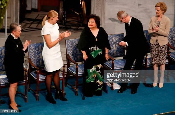 Hiroshima nuclear bombing survivor Setsuko Thurlow is applauded by Berit ReissAndersen chairperson of the Norwegian Nobel Committee Beatrice Fihn...