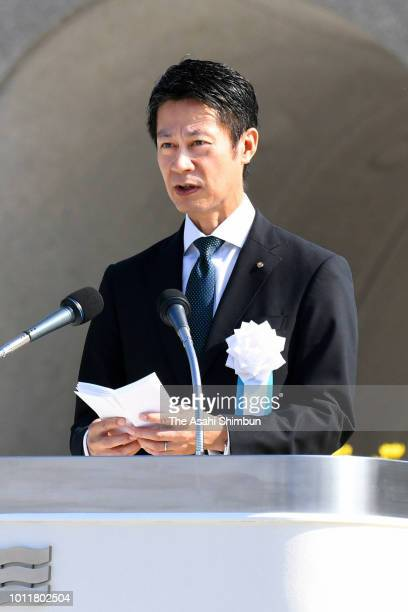 Hiroshima Prefecture Governor Hidehiko Yuzaki addresses during the Peace Memorial Ceremony at Hiroshima Peace Memorial Park on the 73rd anniversary...