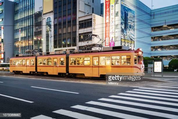 hiroshima streetcar at twilight japan - hiroshima city stock photos and pictures