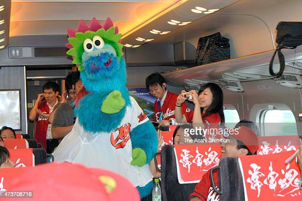 Hiroshima Toyo Carp mascot Slyly entertains fans on board to the special Shinkansen bullet train for the fans on May 16 2015 in Tokyo Japan The...