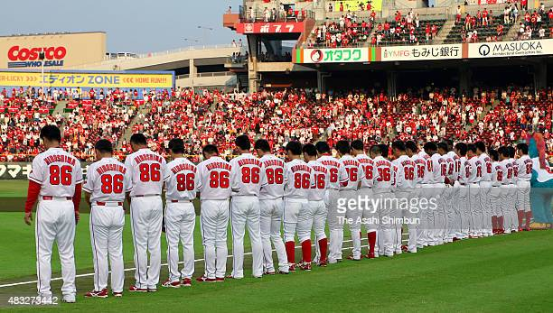 Hiroshima Toyo Carp players wearing special uniform of 'Peace' on the chest and '86' on the back to commemorate August 6 observe a minute of silience...