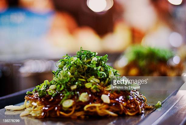 hiroshima-style okonomiyaki - okonomiyaki stock pictures, royalty-free photos & images