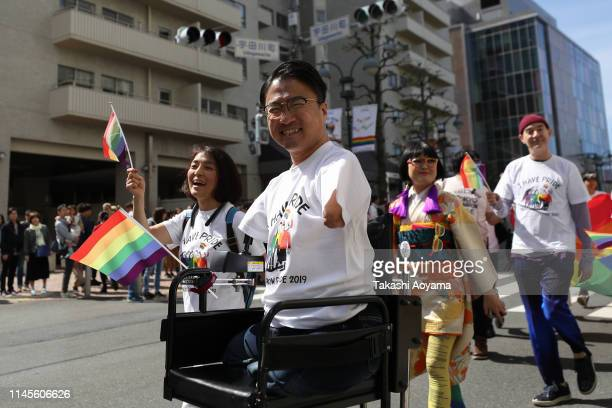 Hirotada Ototake walks down the street during the Tokyo Rainbow Pride Parade on April 28 2019 in Tokyo Japan Thousands from the Japanese LGBT...