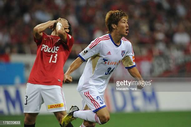 Hirotaka Mita of FC Tokyo celebrates the first goal during the J.League match between Urawa Red Diamonds and FC Tokyo at Saitama Stadium on July 10,...