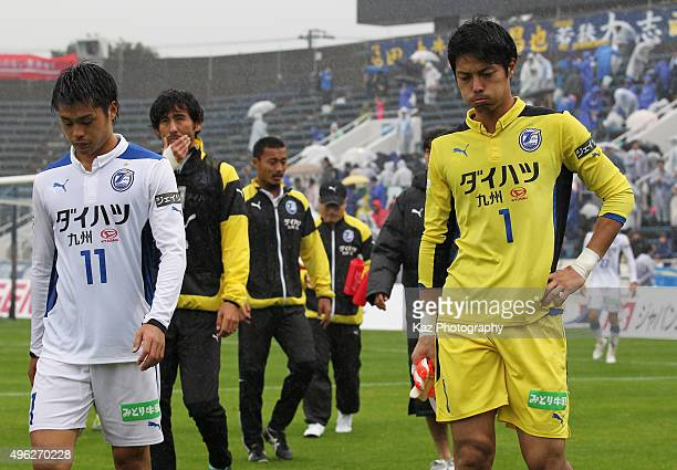 Hirotaka Tameda and Yohei Takeda of Oita Trinita show their dejection after the 01 defeat in the JLeague second division match between Yokohama FC...