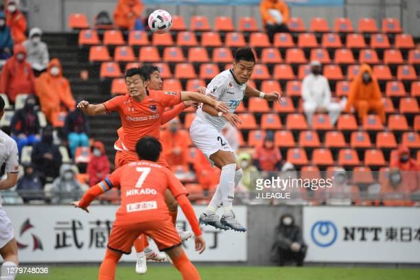 Hiroto HATAO of Omiya Ardija and Yasutaka YANAGI of Tochigi SC battle for the ball during the J.League Meiji Yasuda J2 match between Omiya Ardija and...