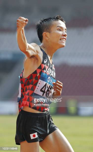 Hiroto Inoue celebrates after winning Japan's first gold in 32 years in the men's marathon at the Asian Games in Jakarta on Aug. 25, 2018. ==Kyodo