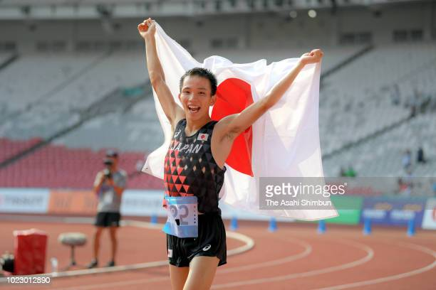 Hiroto Inoue of Japan celebrates winning the gold medal in the Men's Marathon at the GBK Main Stadium on day seven of the Asian Games on August 25,...