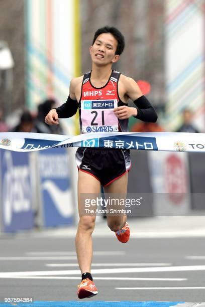 Hiroto Inoue of Japan crosses the finish line during the Tokyo Marathon 2018 in Tokyo, Japan.