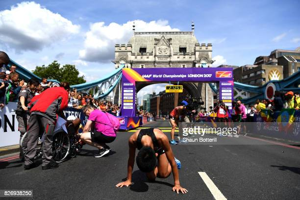 Hiroto Inoue of Japan reacts after crossing the finishline in the Men's Marathon during day three of the 16th IAAF World Athletics Championships...