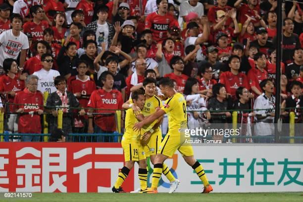 Hiroto Nakagawa of Kashiwa Reysol celebrates scoring the opening goal with his team mates Kosuke Taketomi and Cristiano during the JLeague J1 match...