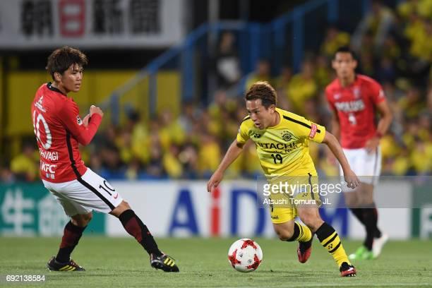 Hiroto Nakagawa of Kashiwa Reysol takes on Yosuke Kashiwagi of Urawa Red Diamonds during the JLeague J1 match between Kashiwa Reysol and Urawa Red...