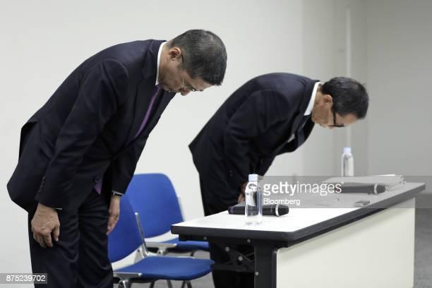 Hiroto Saikawa president and chief executive officer of Nissan Motor Co left and Yasuhiro Yamauchi chief competitive officer of Nissan Motor Co bow...