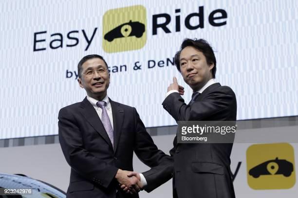 Hiroto Saikawa president and chief executive officer of Nissan Motor Co left and Isao Moriyasu president and chief executive officer of DeNA Co shake...