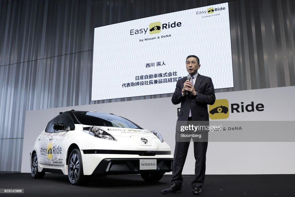 Hiroto Saikawa, president and chief executive officer of Nissan Motor Co., speaks during a news conference for the 'Easy Ride' robot taxi service, jointly developed by Nissan and DeNA Co., at the company's global headquarters in Yokohama, Japan, on Friday, Feb. 23, 2018. The service, which allows the public to use a smartphone app to book 15-minute rides, is scheduled to launch on March 5 for two weeks in Yokohama. Photographer: Kiyoshi Ota/Bloomberg via Getty Images