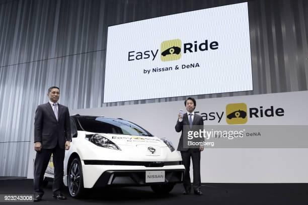 Hiroto Saikawa president and chief executive officer of Nissan Motor Co left and Isao Moriyasu president and chief executive officer of DeNA Co pose...