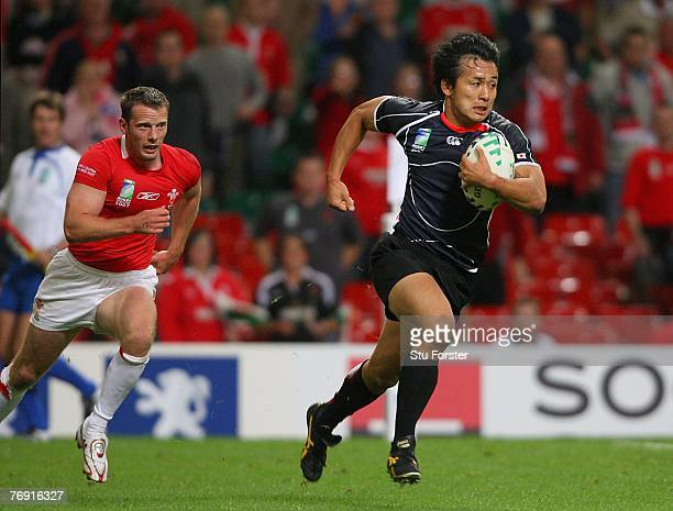 Hirotoki Onozawa of Japan scores a try during the Rugby World Cup 2007 Pool B match between Wales and Japan at the Millennium Stadium on September 20...