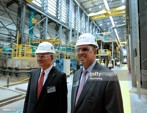 Hiroya Kawasaki president of Kobe Steel Ltd left and John Surma chairman and chief executive officer of United States Steel Corp smile during a tour...