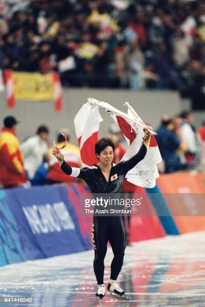 Hiroyasu Shimizu of Japan celebrates winning the gold medal after competing in the second run of the Speed Skating Men's 500m during day three of the...