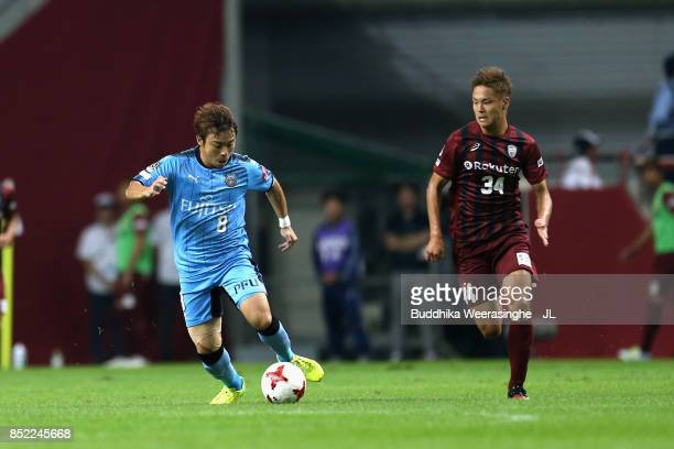 Hiroyuki Abe of Kawasaki Frontale and So Fujitani of Vissel Kobe compete for the ball during the JLeague J1 match between Vissel Kobe and Kawasaki...