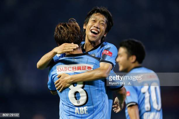 Hiroyuki Abe of Kawasaki Frontale celebrates scoring his side's second goal with his team mate Kengo Nakamura during the JLeague J1 match between...