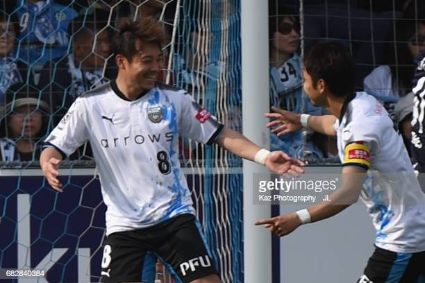 Hiroyuki Abe of Kawasaki Frontale celebrates scoring the opening goal with his team mates during the JLeague J1 match between Jubilo Iwata and...