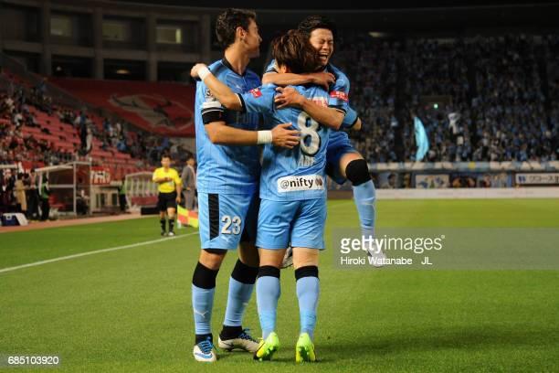 Hiroyuki Abe of Kawasaki Frontale celebrates scoring the opening goal with his team mates Eduardo and Tatsuya Hasegawa during the J.League J1 match...
