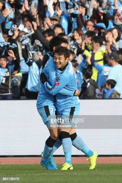 Hiroyuki Abe of Kawasaki Frontale celebrates scoring the opening goal with his team mate Shintaro Kurumaya during the JLeague J1 match between...