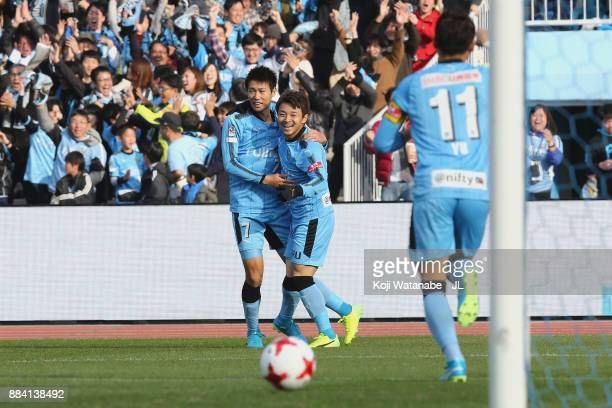 Hiroyuki Abe of Kawasaki Frontale celebrates scoring the opening goal with his team mate Shintaro Kurumaya and Yu Kobayashi during the JLeague J1...