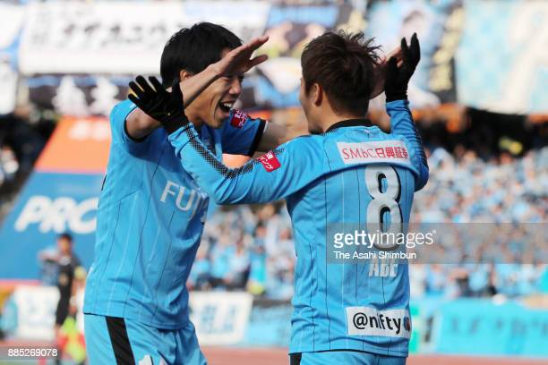 Hiroyuki Abe of Kawasaki Frontale celebrates scoring the opening goal with his team mate Kengo Nakamura during the JLeague J1 match between Kawasaki...