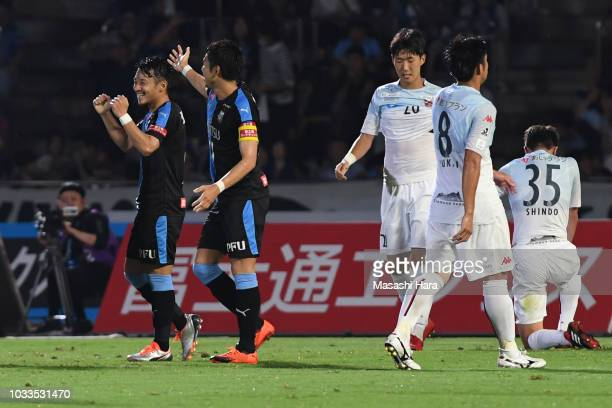 Hiroyuki Abe of Kawasaki Frontale celebrates the third goal with supportersduring the JLeague J1 match between Kawasaki Frontale and Consadole...