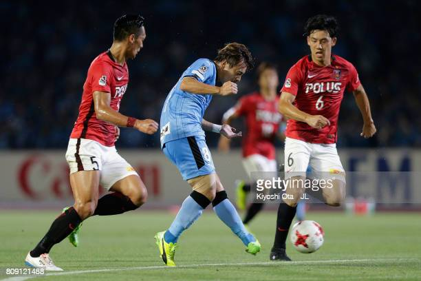 Hiroyuki Abe of Kawasaki Frontale scores his side's second goal during the JLeague J1 match between Kawasaki Frontale and Urawa Red Diamonds at...