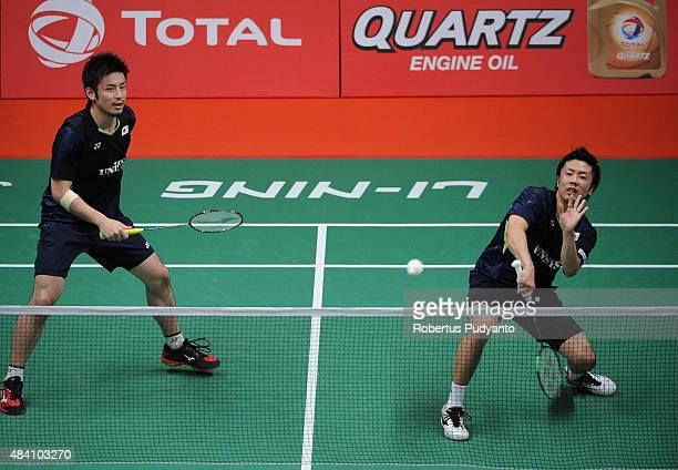 Hiroyuki Endo and Kenichi Hayakawa of Japan compete against Liu Xiaolong and Qiu Zihan of China in the semi final match of the 2015 Total BWF World...