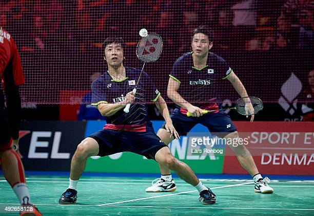 Hiroyuki ENDO and Kenichi HAYAKAWA of Japan in action during Day Two at the MetLife BWF World Superseries Premier Yonex Denmark Open Badminton at...