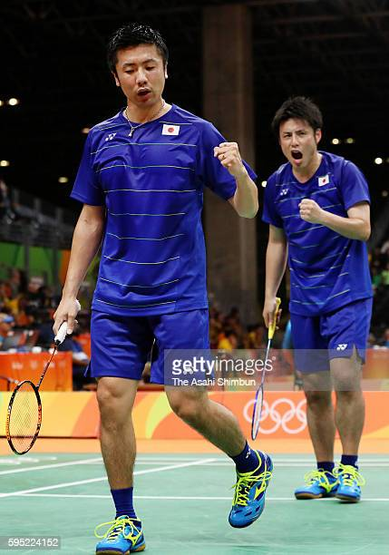 Hiroyuki Endo and Kenichi Hayakawa of Japan react after a point against Marcus Ellis and Chris Langridge of Great Britain in the Men's Doubles...