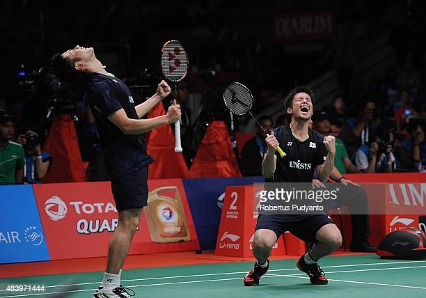 Hiroyuki Endo and Kenichi Hayakawa of Japan react after defeating Angga Pratama and Ricky Karanda Suwardi of Indonesia in the quarter final match of...