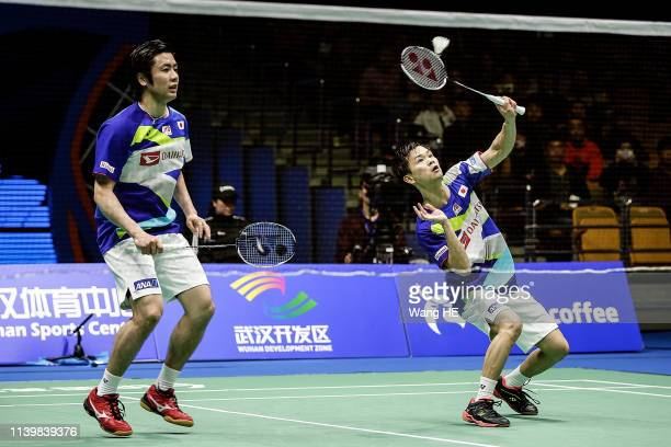 Hiroyuki Endo and Yata Watanabe of Japan react during men's doubles final match against Marcus Ferndldi Gideon and Kevin Sanjaya Sukamulio of...