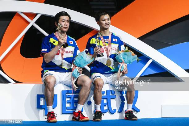 Hiroyuki Endo and Yuta Watanabe of Japan celebrate during the awards ceremony after the Men's Doubles final match against Marcus Fernaldi Gideon and...