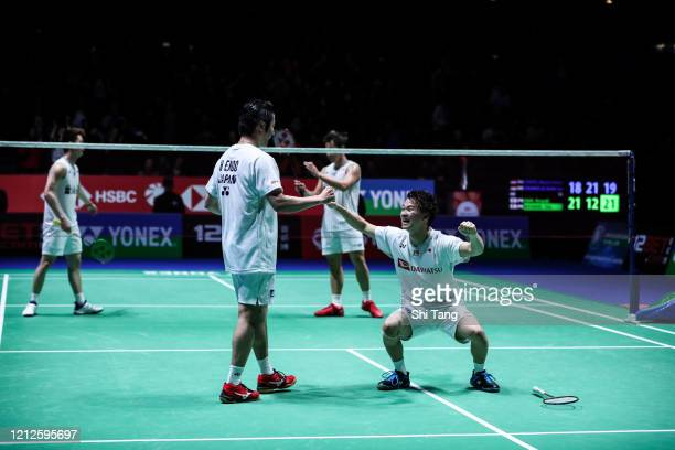 Hiroyuki Endo and Yuta Watanabe of Japan celebrate the victory in the Men's Double final match against Marcus Fernaldi Gideon and Kevin Sanjaya...