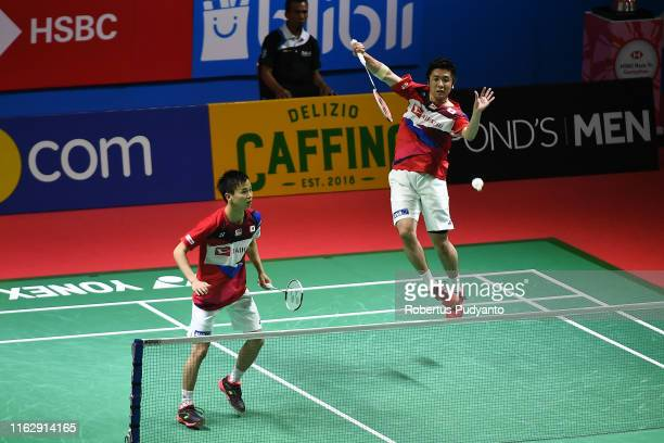 Hiroyuki Endo and Yuta Watanabe of Japan compete against Mohammad Ahsan and Hendra Setiawan of Indonesia on day four of the Bli Bli Indonesia Open at...