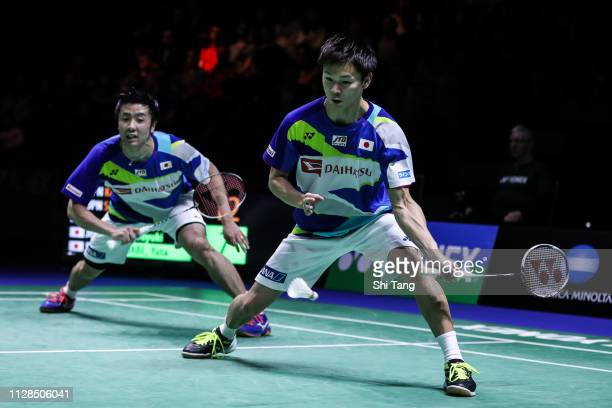 Hiroyuki Endo and Yuta Watanabe of Japan compete in the Men's Double final match against Takeshi Kamura and Keigo Sonoda of Japan during day six of...