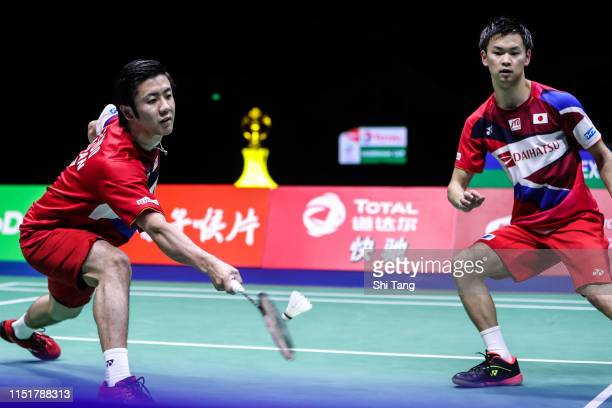 Hiroyuki Endo and Yuta Watanabe of Japan compete in the Men's Double final match against Li Junhui and Liu Yuchen of China during day eight of the...