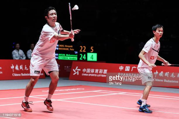 Hiroyuki Endo and Yuta Watanabe of Japan compete in the Men's Double final match against Hendra Setiawan and Mohammad Ahsan of Indonesia during day...