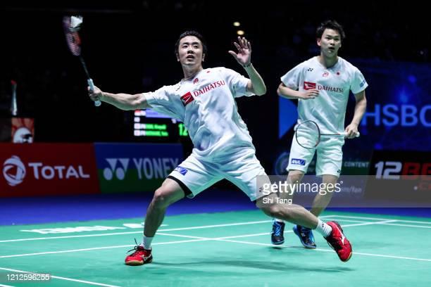 Hiroyuki Endo and Yuta Watanabe of Japan compete in the Men's Double final match against Marcus Fernaldi Gideon and Kevin Sanjaya Sukamuljo of...