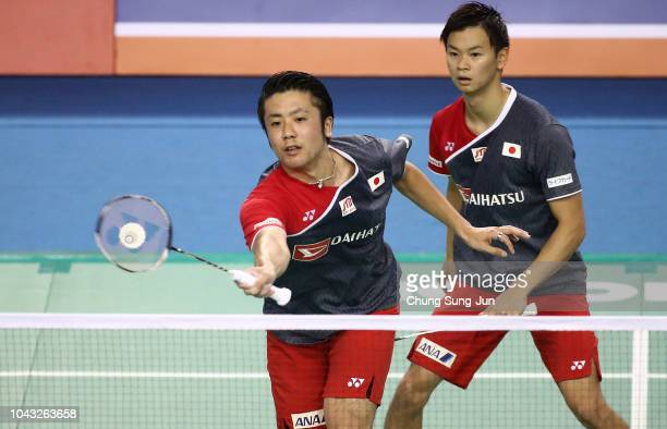 Hiroyuki Endo and Yuta Watanabe of Japan compete in the Men's Doubles Final against Takuro Hoki and Yugo Kobayashi of Japan on day six of the...