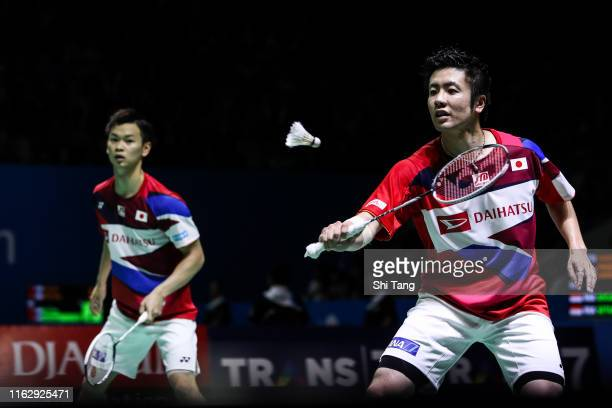 Hiroyuki Endo and Yuta Watanabe of Japan compete in the Men's Doubles quarter finals match against Mohammad Ahsan and Hendra Setiawan of Indonesia on...