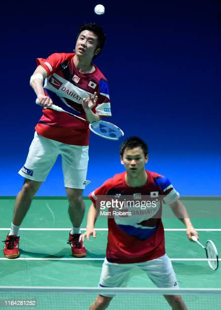 Hiroyuki Endo and Yuta Watanabe of Japan compete in the Men's Doubles Quarterfinal match against Li Jun Hui and Liu Yu Chen of China on day four of...